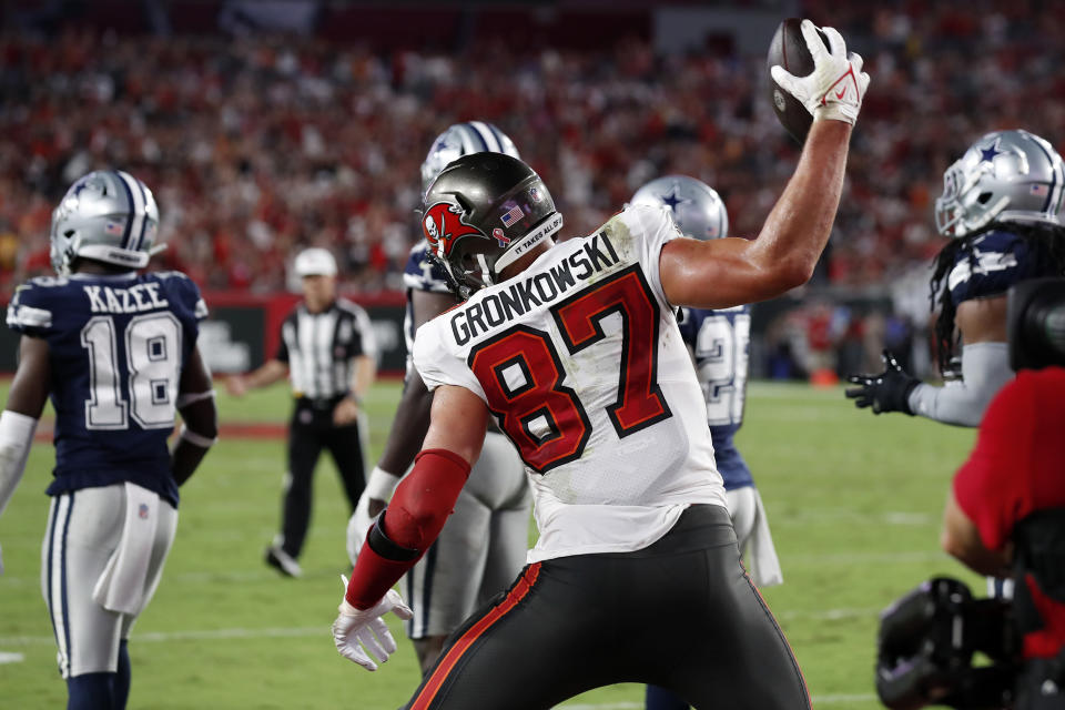 Tampa Bay Buccaneers tight end Rob Gronkowski (87) spikes the football after his 2-yard touchdown reception against the Dallas Cowboys during the first half of an NFL football game Thursday, Sept. 9, 2021, in Tampa, Fla. (AP Photo/Scott Audette)
