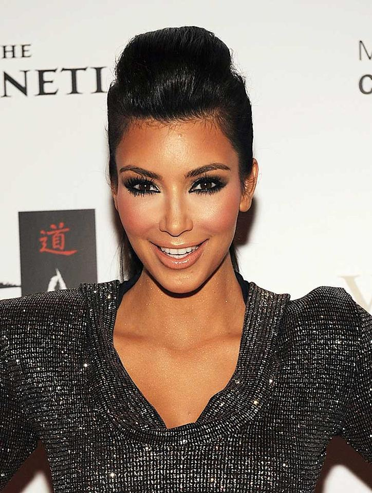 """Reality TV starlet Kim Kardashian sexy signature look usually consists of a voluminous or upswept 'do, a bronze glow, and -- most importantly -- dark, sultry eyes. Denise Truscello/<a href=""""http://www.wireimage.com"""" target=""""new"""">WireImage.com</a> - October 16, 2009"""