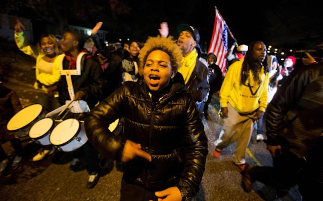 <p>Sabrina Webb, a cousin of Michael Brown, leads a protest near the site where the black 18-year-old was shot and killed by a white police officer in Ferguson, Mo on November 22, 2014. Hours after the announcement on November 24, 2017, that Officer Darren Wilson would not be indicted in the killing of Michael Brown, DeAndre Joshua, Webb's friend, was shot and killed. (AP Photo/David Goldman) </p>