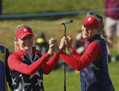 Sisters Nelly, left, and Jessica Korda of the US celebrate on the 14th after winning their Foursomes match 6 up against Solheim cup at Gleneagles, Auchterarder, Scotland, Friday, Sept. 13, 2019. The Solheim cup runs from 13-15 Sept. (AP Photo/Peter Morrison)