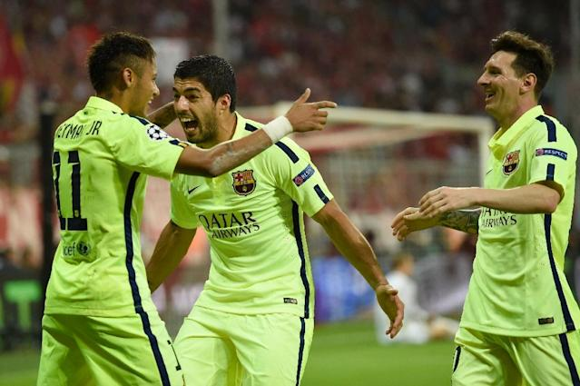 Barcelona's forward Neymar (L) celebrates scoring with Luis Suarez (C) and Lionel Messi during the UEFA Champions League football match semi final against Bayern Munich on May 12, 2015 (AFP Photo/Odd Andersen)