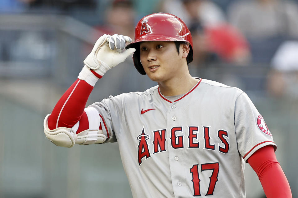 Los Angeles Angels' Shohei Ohtani tips his cap toward the New York Yankees' dugout before batting during the first inning of a baseball game Wednesday, June 30, 2021, in New York. (AP Photo/Adam Hunger)