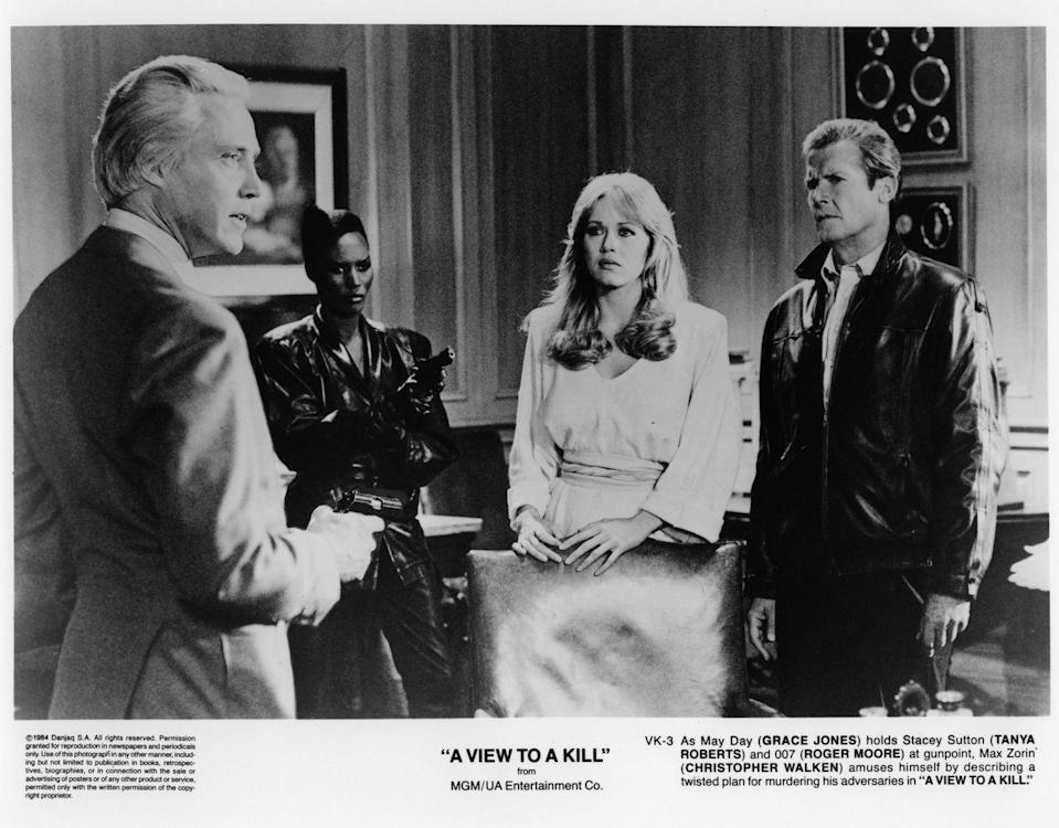 <p>Christopher Walken holds Roger Moore and Tanya Roberts at gunpoint with the help of Grace Jones in a scene from 'A View to a Kill', 1984. </p>