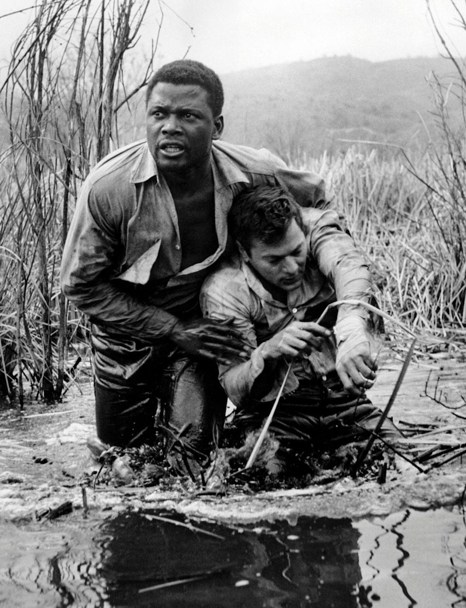 <p>With Tony Curtis in 1959's <em>The Defiant Ones,</em> for which he earned an Oscar nomination. </p>