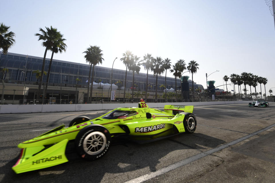 IndyCar driver Simon Pagenaud, from Montmorillon, France, makes the turn onto Seaside Way from Pine Avenue during the final practice session at the Acura Grand Prix of Long Beach, Saturday, Sept. 25, 2021, in Long Beach, Calif. (Will Lester/The Orange County Register via AP)