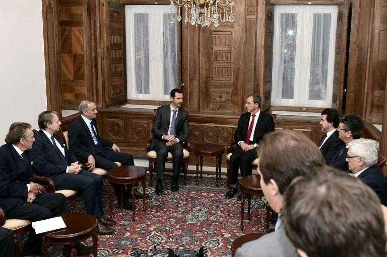 A handout picture provided by the Syrian Arab News Agency shows President Bashar al-Assad (C-L) speaking with French National Assembly member Thierry Mariani (C-R), the president of a delegation of parliamentarians, in Damascus on November 14, 2015
