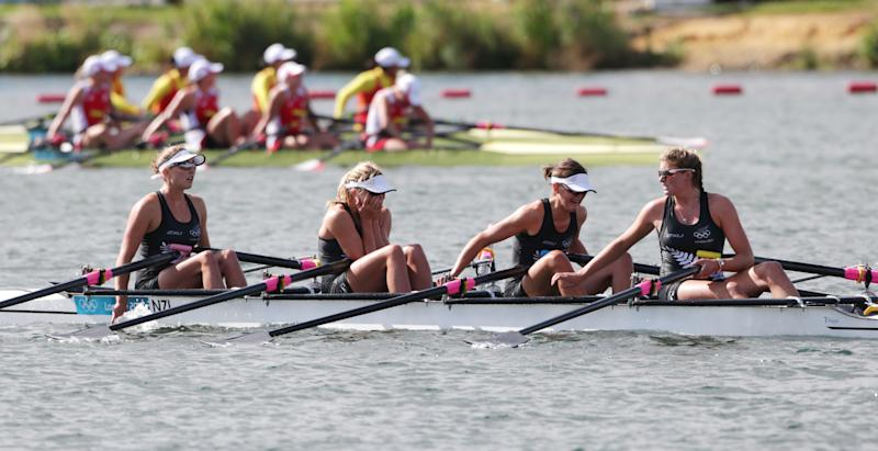 New Zealand's crew members, right to left, Eve Macfarlane, Fiona Bourke, Louisa Trappitt, and Sarah Gray react after finishing last in a women's rowing quadruple sculls repechage in Eton Dorney, near Windsor, England, at the 2012 Summer Olympics, Monday, July 30, 2012. (AP Photo/Armando Franca)