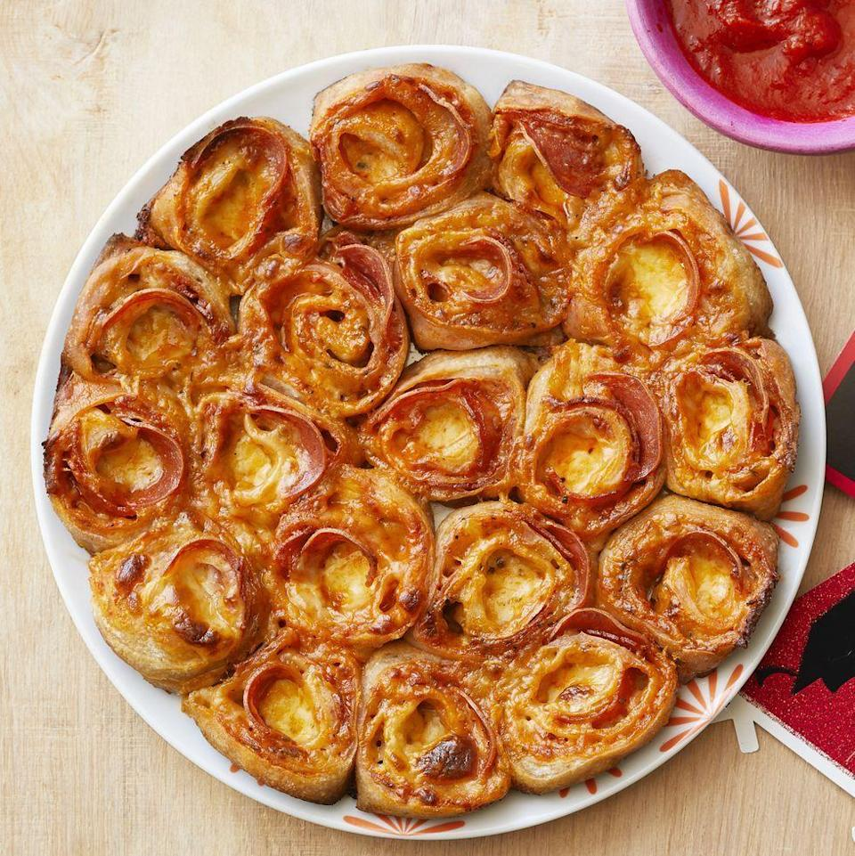 """<p>Whether you're spending Thanksgiving Day watching football or preparing the feast, you'll want these cheesy pizza rolls for snacking on. Top them with your family's favorite pizza toppings. </p><p><a href=""""https://www.thepioneerwoman.com/food-cooking/recipes/a36080818/pepperoni-pizza-rolls-recipe/"""" rel=""""nofollow noopener"""" target=""""_blank"""" data-ylk=""""slk:Get Ree's recipe."""" class=""""link rapid-noclick-resp""""><strong>Get Ree's recipe. </strong></a></p><p><a class=""""link rapid-noclick-resp"""" href=""""https://go.redirectingat.com?id=74968X1596630&url=https%3A%2F%2Fwww.walmart.com%2Fsearch%3Fq%3Dpioneer%2Bwoman%2Bbaking%2Bdishes&sref=https%3A%2F%2Fwww.thepioneerwoman.com%2Ffood-cooking%2Fmeals-menus%2Fg37320750%2Fthanksgiving-appetizers%2F"""" rel=""""nofollow noopener"""" target=""""_blank"""" data-ylk=""""slk:SHOP BAKING DISHES"""">SHOP BAKING DISHES</a></p>"""