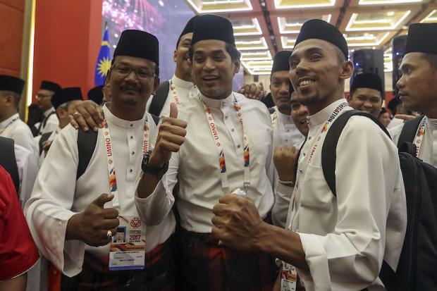 Umno Youth Chief Khairy Jamaluddin poses for a picture with delegates after the party wing's general assembly at Putra World Trade Centre (PWTC) in Kuala Lumpur December 6, 2017. — Picture by Yusof Mat Isa