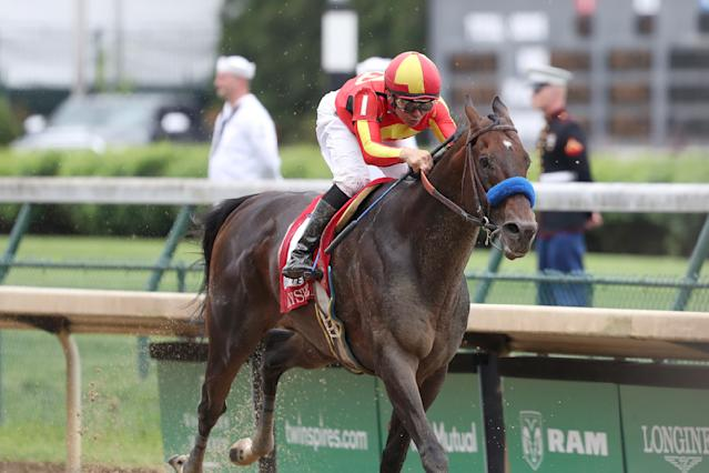 FILE - In this May 3, 2019, file photo, McKinzie, ridden by jockey Mike Smith, wins the Grade 2 Alysheba horse race at Churchill Downs in Louisville, Ky. The Breeders Cup Classic pits West Coast star McKinzie against Code of Honor, the Easts top horse who finished second in the Kentucky Derby. (AP Photo/Gregory Payan, File)