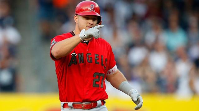 NEW YORK (AP) — Mike Trout homered and doubled three times during his first five-hit game in the majors, and the Los Angeles Angels quickly erased an early deficit in beating the New York Yankees 11-4 on Saturday night.