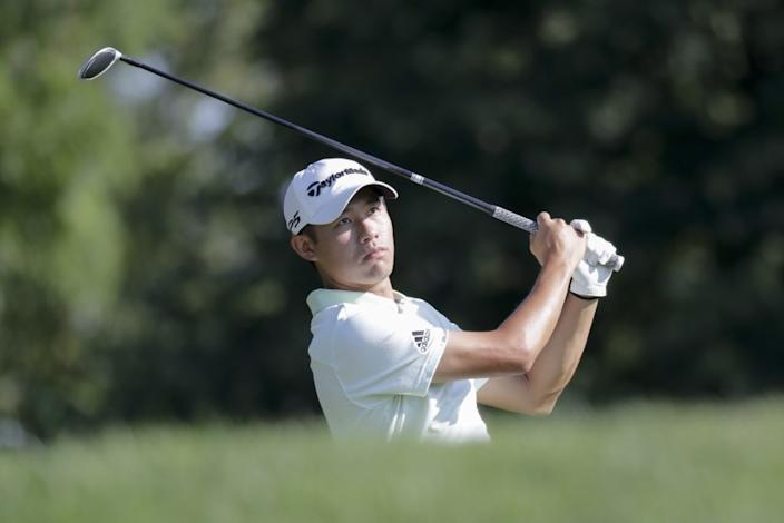 "Collin Morikawa watches the ball after hitting from the third tee during a practice round for the Memorial golf tournament on July 15. <span class=""copyright"">(Darron Cummings / Associated Press)</span>"