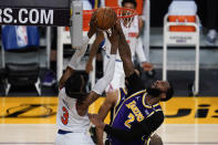 Los Angeles Lakers center Andre Drummond (2) blocks a shot by New York Knicks center Nerlens Noel (3) during the third quarter of a basketball game Tuesday, May 11, 2021, in Los Angeles. (AP Photo/Ashley Landis)