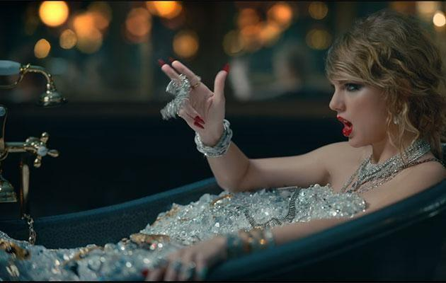In this scene from 'Look What You Made Me Do' Taylor resides in a bath and is surrounded by diamonds. Fans have theorised the scene mirrors Kim's infamous Paris robbery. Source: YouTube