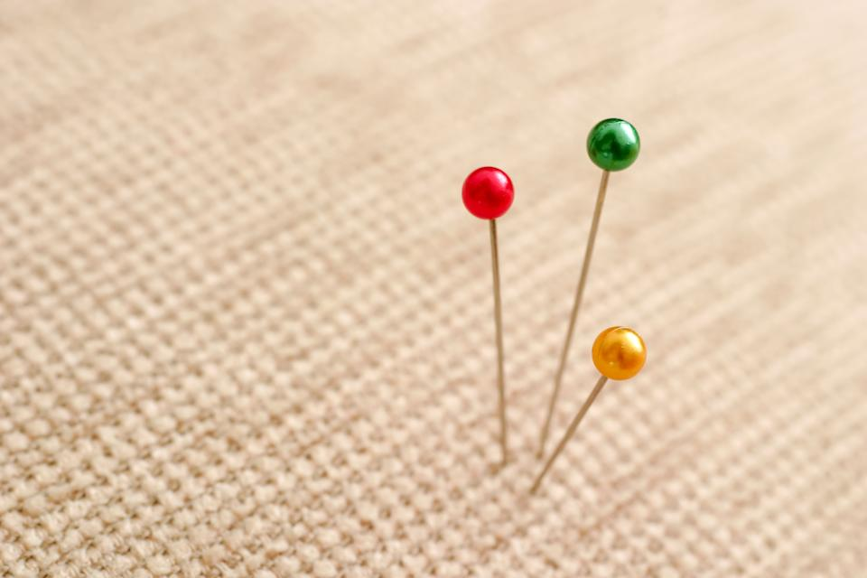 Sewing pins in fabric