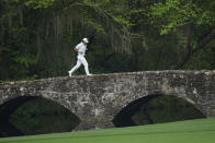 Hideki Matsuyama, of Japan, runs across the Nelson Bridge on the 13th hole during the third round of the Masters golf tournament on Saturday, April 10, 2021, in Augusta, Ga. (AP Photo/David J. Phillip)