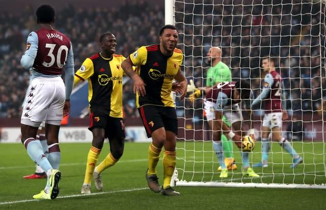 Troy Deeney, right, celebrates his opener (David Davies/PA)
