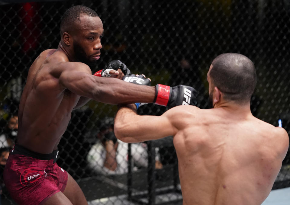 LAS VEGAS, NEVADA - MARCH 13: (L-R) Leon Edwards of Jamaica punches Bulal Muhammad in a welterweight fight during the UFC Fight Night event at UFC APEX on March 13, 2021 in Las Vegas, Nevada. (Photo by Jeff Bottari/Zuffa LLC via Getty Images)