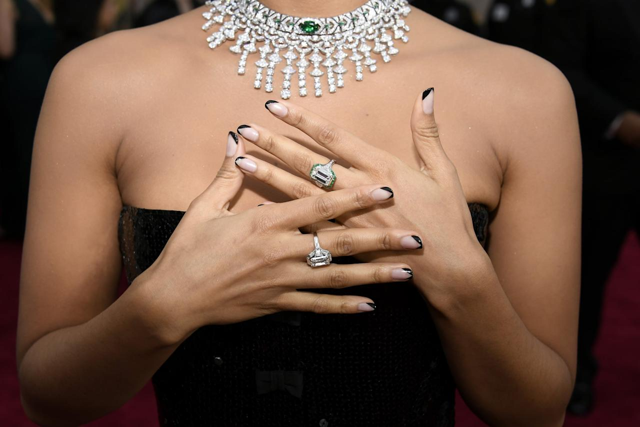 """<p>The darkest twist on the classic french manicure on Oscar night came courtesy of Beetz's <a href=""""https://www.popsugar.com/beauty/french-moon-nail-art-trend-46912023"""" class=""""ga-track"""" data-ga-category=""""Related"""" data-ga-label=""""https://www.popsugar.com/beauty/french-moon-nail-art-trend-46912023"""" data-ga-action=""""In-Line Links"""">""""french moon"""" nail art</a>, where her tips were outlined in black and painted in a v-shape.</p>"""