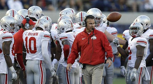 Ohio State coach Urban Meyer, center, speaks with players during the second half of an NCAA college football game against California, Saturday, Sept. 14, 2013, in Berkeley, Calif. (AP Photo/Ben Margot)