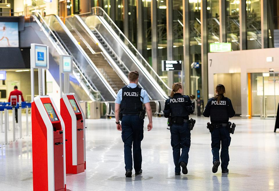 17 March 2020, Hessen, Frankfurt/Main: Three policemen walk through Terminal 1 at the airport. The spokesman for the federal police at the airport has announced an immediate entry ban for non-EU citizens at German airports due to the corona crisis. This regulation will be implemented on Tuesday evening. Photo: Andreas Arnold/dpa (Photo by Andreas Arnold/picture alliance via Getty Images)