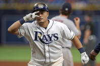 Tampa Bay Rays' Ji-Man Choi signals to the dugout after his single in the eighth inning of a baseball game against the Houston Astros, Saturday, March 30, 2019, in St. Petersburg, Fla. (AP Photo/Mike Carlson)