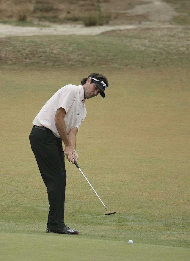 Bubba Watson putts on the 11th hole during the second round of the U.S. Open golf tournament in Pinehurst, N.C., Friday, June 13, 2014. (AP Photo/Charlie Riedel)