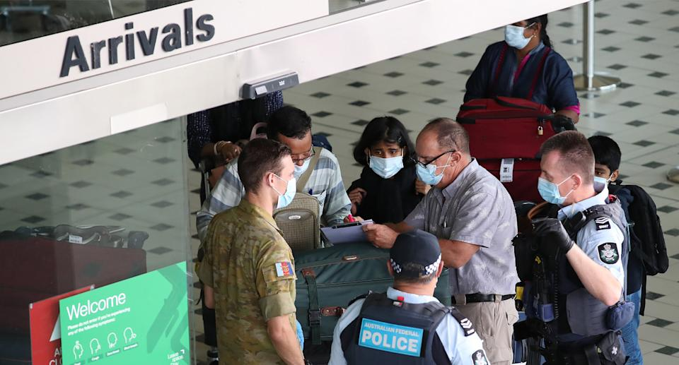 The two travellers entered Australia on Thursday and mistakenly were allowed into the green zone. Source: AAP
