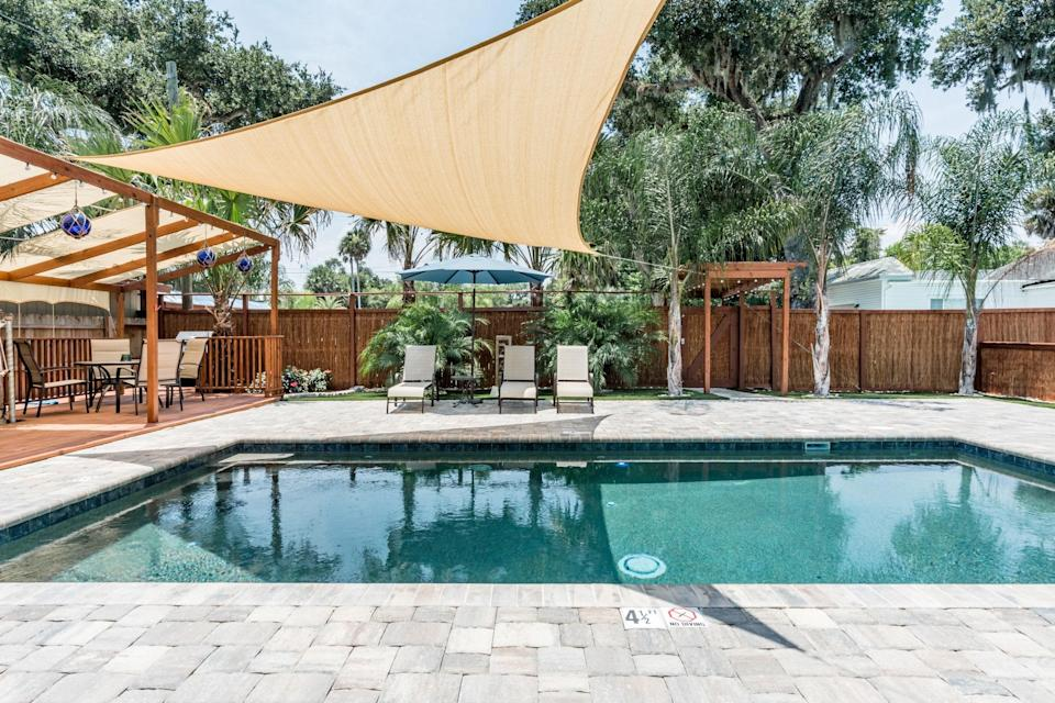 """<p>Florida is hardly lacking pools, but this New Smyrna Beach rental (about an hour outside of <a href=""""https://www.cntraveler.com/gallery/best-airbnbs-in-orlando?mbid=synd_yahoo_rss"""" rel=""""nofollow noopener"""" target=""""_blank"""" data-ylk=""""slk:Orlando"""" class=""""link rapid-noclick-resp"""">Orlando</a>) has one that measures a head above the rest: the sails keep it partially shaded, which you'll no doubt appreciate on hot summer days. Surrounding the pool are lounge chairs, outdoor table seating, and a hammock, with an outdoor shower and soaking tub nearby. Inside, the modern home is all clean lines and white walls, with three bedrooms and two full bathrooms, meaning it can sleep up to six comfortably.</p> <p><strong>Book now:</strong> <a href=""""https://airbnb.pvxt.net/rmW4y"""" rel=""""nofollow noopener"""" target=""""_blank"""" data-ylk=""""slk:From $200 per night, airbnb.com"""" class=""""link rapid-noclick-resp"""">From $200 per night, airbnb.com</a></p>"""
