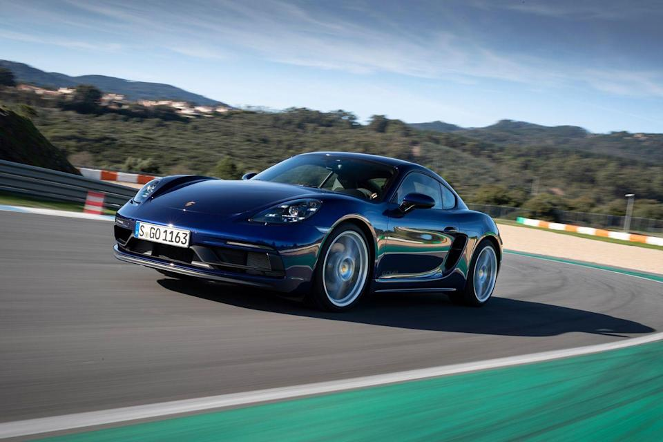 "<p>The <a href=""https://www.caranddriver.com/porsche/718-cayman"" rel=""nofollow noopener"" target=""_blank"" data-ylk=""slk:2021 Porsche 718 Cayman"" class=""link rapid-noclick-resp"">2021 Porsche 718 Cayman</a> captures the same physical and emotional excitement of driving that supercars do. This coupe and its convertible sibling—the 718 Boxster, which <a href=""https://www.caranddriver.com/porsche/718-boxster"" rel=""nofollow noopener"" target=""_blank"" data-ylk=""slk:we review separately"" class=""link rapid-noclick-resp"">we review separately</a>—provide unrivaled driver engagement among <a href=""https://www.caranddriver.com/features/g27197524/best-sports-cars/"" rel=""nofollow noopener"" target=""_blank"" data-ylk=""slk:sports cars"" class=""link rapid-noclick-resp"">sports cars</a>. The Cayman's otherworldly chassis provides an open line of communication between the driver, the car, and the road. To create the 718, <a href=""https://www.caranddriver.com/porsche"" rel=""nofollow noopener"" target=""_blank"" data-ylk=""slk:Porsche"" class=""link rapid-noclick-resp"">Porsche</a> knits together strong brakes, an unflappable suspension, and a steering system rich with feedback. The result is so good that both 718 body styles made <a href=""https://www.caranddriver.com/features/a34690717/10best-2021-porsche-718-boxster-cayman/"" rel=""nofollow noopener"" target=""_blank"" data-ylk=""slk:our 2021 10Best list"" class=""link rapid-noclick-resp"">our 2021 10Best list</a>. The brand's flawless automatic and manual transmissions and potent engines—particularly the melodic flat-six—complete the picture. While the 2021 Cayman costs more than its distinguished rivals, the <a href=""https://www.caranddriver.com/chevrolet/corvette"" rel=""nofollow noopener"" target=""_blank"" data-ylk=""slk:Chevy Corvette"" class=""link rapid-noclick-resp"">Chevy Corvette</a> and <a href=""https://www.caranddriver.com/toyota/supra"" rel=""nofollow noopener"" target=""_blank"" data-ylk=""slk:Toyota Supra"" class=""link rapid-noclick-resp"">Toyota Supra</a>, it's still the most focused and satisfying choice in the segment.</p><p><a class=""link rapid-noclick-resp"" href=""https://www.caranddriver.com/porsche/718-cayman"" rel=""nofollow noopener"" target=""_blank"" data-ylk=""slk:Review, Pricing, and Specs"">Review, Pricing, and Specs</a></p>"