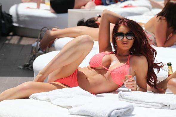 Amy Childs soaks up the sun in orange bikini in Marbella