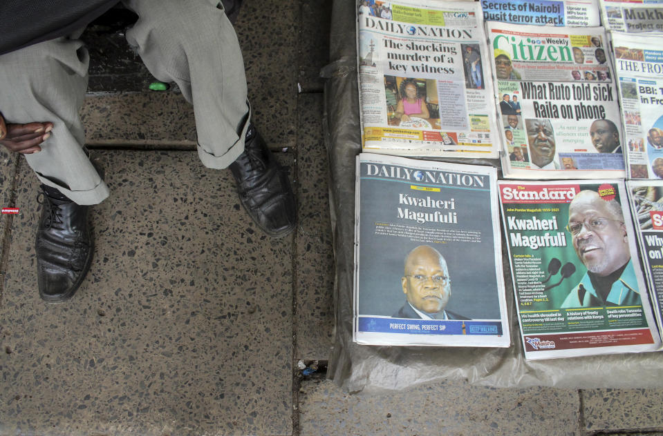 """A newspaper stand displays front pages reporting the death of neighboring Tanzania's President John Magufuli with headlines in Swahili reading """"Goodbye Magufuli"""", on a street in Nairobi, Kenya Thursday, March 18, 2021. Magufuli, a prominent COVID-19 skeptic whose populist rule often cast his country in a harsh international spotlight, died Wednesday aged 61 of heart failure, it was announced by Vice President Samia Suluhu. Headline in Swahili reads """"Goodbye Magufuli."""" (AP Photo)"""