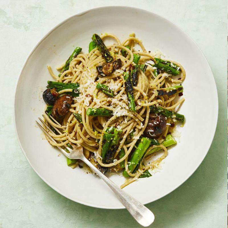 """<p>Ditch the classic meatballs and sauce and incorporate stir-fried veggies into your next pasta dish. </p><p><em><a href=""""https://www.womansday.com/food-recipes/a32699458/whole-wheat-spaghetti-with-grilled-asparagus-and-scallions-recipe/"""" rel=""""nofollow noopener"""" target=""""_blank"""" data-ylk=""""slk:Get the Whole-Wheat Spaghetti with Grilled Asparagus and Scallions recipe."""" class=""""link rapid-noclick-resp"""">Get the Whole-Wheat Spaghetti with Grilled Asparagus and Scallions recipe.</a></em></p>"""