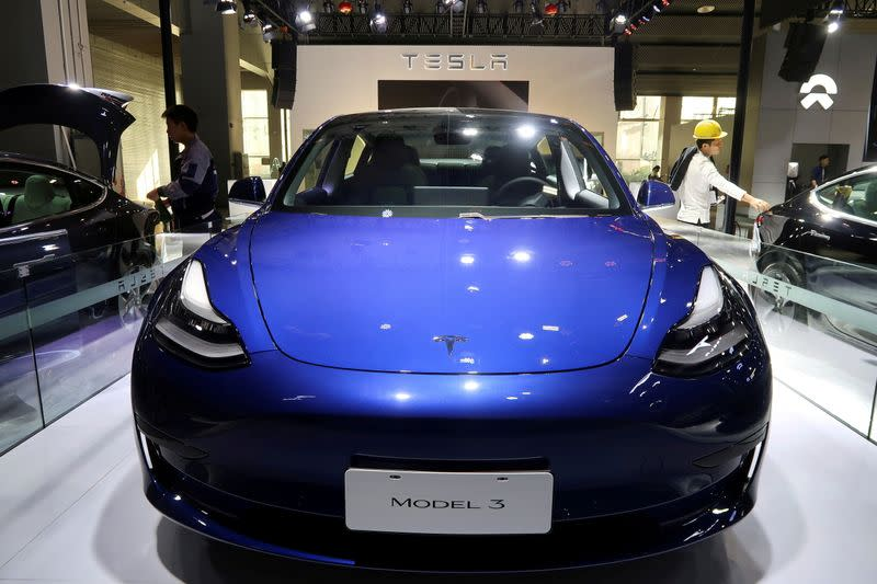 FILE PHOTO: A China-made Tesla Model 3 electric vehicle is seen ahead of the Guangzhou auto show