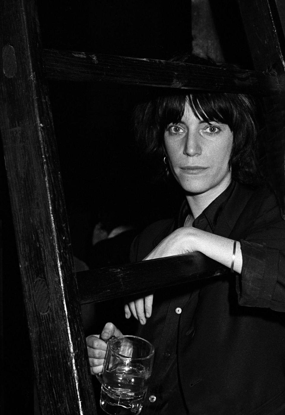 <p>Patti Smith posed backstage before performing with the Patti Smith Group at CBGB's club in New York City on April 4, 1975.</p>