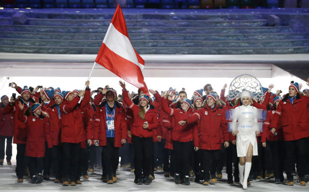 Mario Strecher of Austria carries the national flag as he leads the team during the opening ceremony of the 2014 Winter Olympics in Sochi, Russia, Friday, Feb. 7, 2014. (AP Photo/Mark Humphrey)