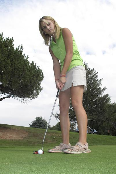 In this photo taken Thursday, Sept. 6, 2012, Sierra Harr, who helped the Castleford High School boy's golf team win Idaho's 2A championship in May, poses for a photograph while putting at the Clear Lakes Country Club near Buhl, Idaho. The Idaho High School Activities Association is mulling rule changes that could prevent the 16-year-old from golfing with the boy's team this spring. (AP Photo/John Miller)
