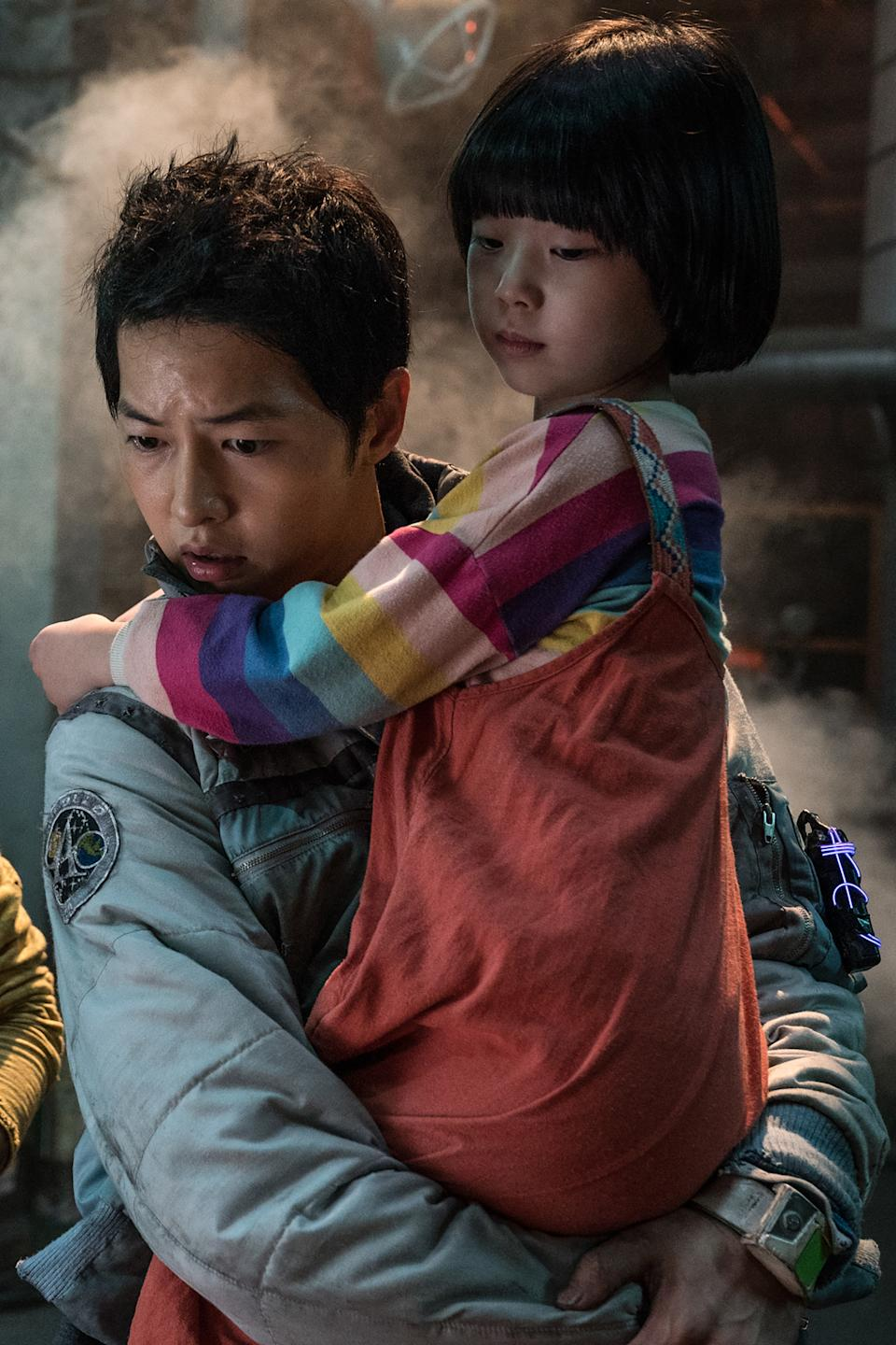 Song Joong Ki (left) and Park Ye Rin in Space Sweepers. (Photo: Netflix)