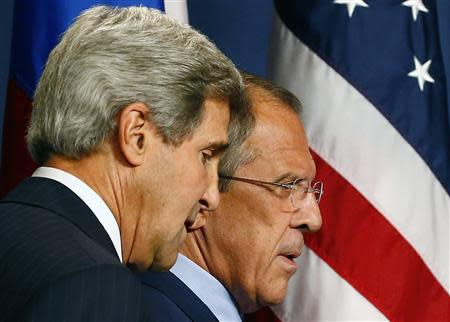Russia's Foreign Minister Lavrov and U.S. Secretary of State Kerry arrive for a news conference at a hotel in Geneva