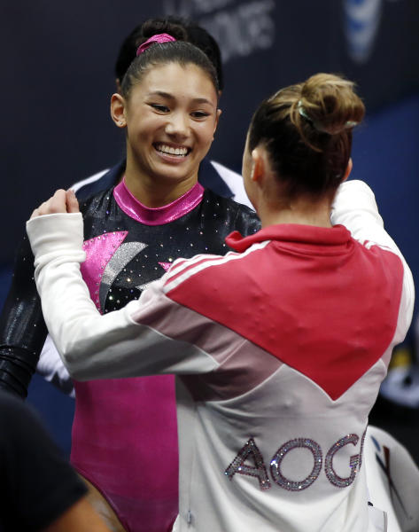 Kyla Ross, left, receives a hug from McKayla Maroney after the first round of the U.S. women's national gymnastics championships in Hartford, Conn., Thursday, Aug. 15, 2013. (AP Photo/Elise Amendola)