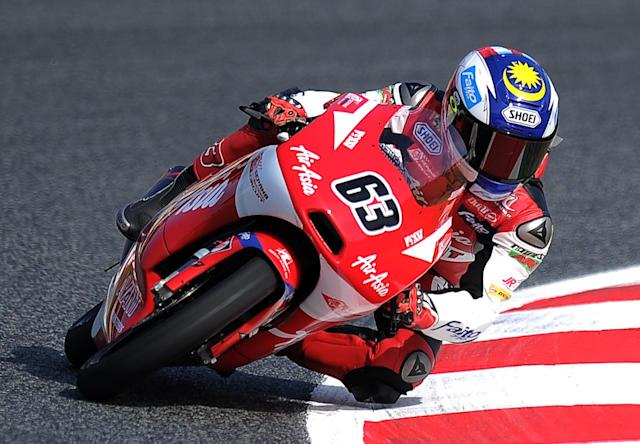 AirAsia-Sic-Ajo's Malaisian Zulfahmi Khairuddin takes a curve at the Catalunya racetrack in Montmelo, near Barcelona, on June 2, 2012, during the Moto3 qualifying session of the Catalunya Moto GP Grand Prix. Malaisian Zulfahmi Khairuddin placed second. AFP PHOTO/LLUIS GENELLUIS GENE/AFP/GettyImages