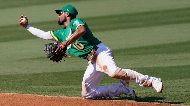 Mandatory Credit: Photo by Ashley Landis/AP/Shutterstock (10935355af)Oakland Athletics shortstop Marcus Semien (10) reaches for an infield single hit by Houston Astros' Kyle Tucker during the fourth inning of Game 2 of a baseball American League Division Series in Los AngelesALDS Astros Athletics Baseball, Los Angeles, United States - 06 Oct 2020.