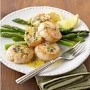 <p>In this 15-minute recipe, crisp and tender asparagus spears serve as a vibrant base for lemon- and tarragon-flavored sea scallops.</p>