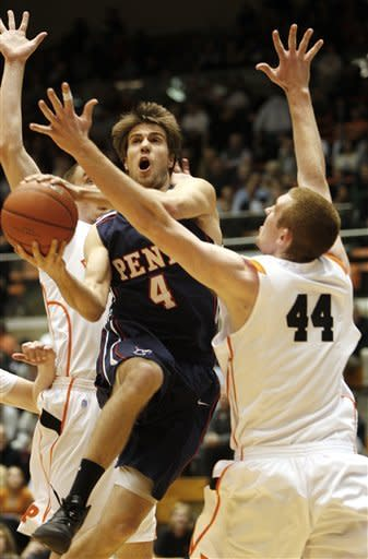 Pennsylvania's Tyler Bernardini (4) goes to the net around Princeton's Brendan Connolly (44) during the first half of an NCAA college basketball game in Princeton, N.J. on Tuesday, March 6, 2012. (AP Photo/Tim Larsen)