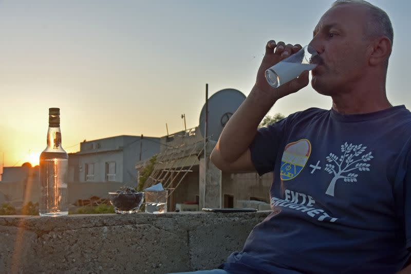 Saad Hussein, an Iraqi Yazidi, drinks Arak that he produces out of dates, on the outskirts of Mosul