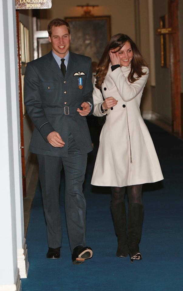Britain's Prince William (L) is pictured with his girlfriend Kate Middleton after his graduation ceremony at RAF Cranwell air base in Lincolnshire, on April 11, 2008. Britain's Prince William graduated as a Royal Air Force (RAF) pilot on Friday after successfully completing an intensive flying course.The prince, 25, received his wings from his father Prince Charles in a graduation ceremony at the RAF Cranwell air base in Lincolnshire, east central England. AFP PHOTO/MICHAEL DUNLEA/POOL (Photo credit should read MICHAEL DUNLEA/AFP via Getty Images)