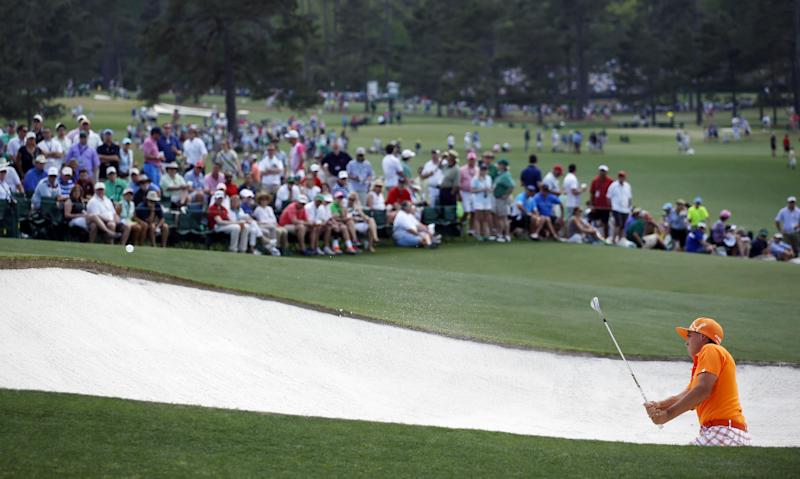 Rickie Fowler hits out of a bunker on the ninth hole during the fourth round of the Masters golf tournament Sunday, April 13, 2014, in Augusta, Ga. (AP Photo/Matt Slocum)