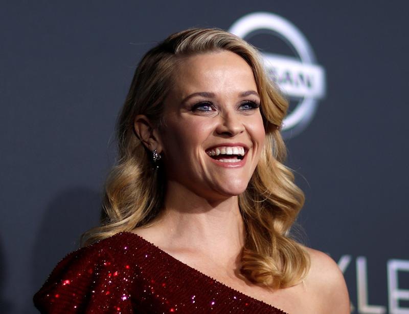 "Reese Witherspoon poses at the premiere of ""A Wrinkle in Time."" Her new series will share ""the stories of extraordinary women who have created their own unique paths to success."""