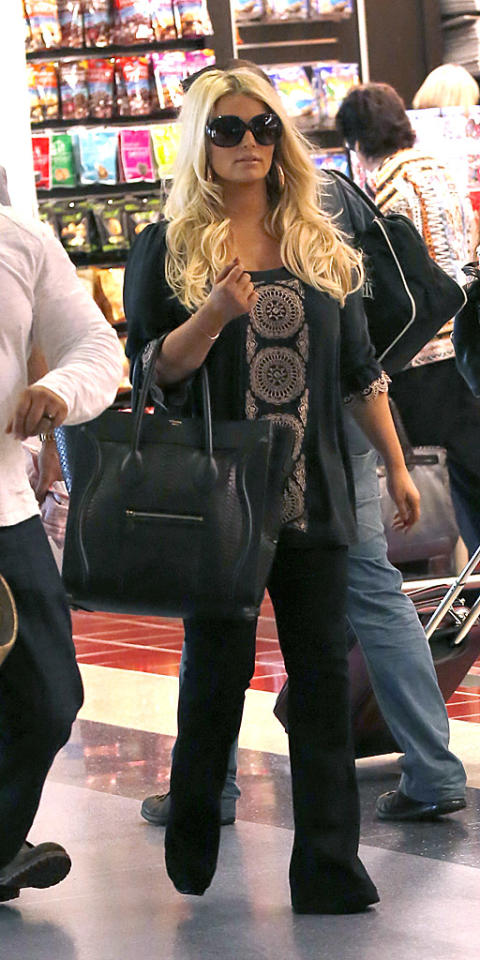 Jessica Simpson shows off her new slimmer figure as she boards a flight out of Los Angeles. The blonde actress/fashion designer was seen with her fiance, Eric Johnson at LAX.