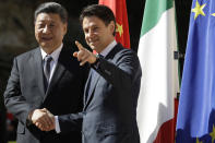 Chinese President Xi Jinping, left, and Italian Premier Giuseppe Conte shake their hands as they meet at Rome's Villa Madama, Saturday, March 23, 2019. (AP Photo/Andrew Medichini)